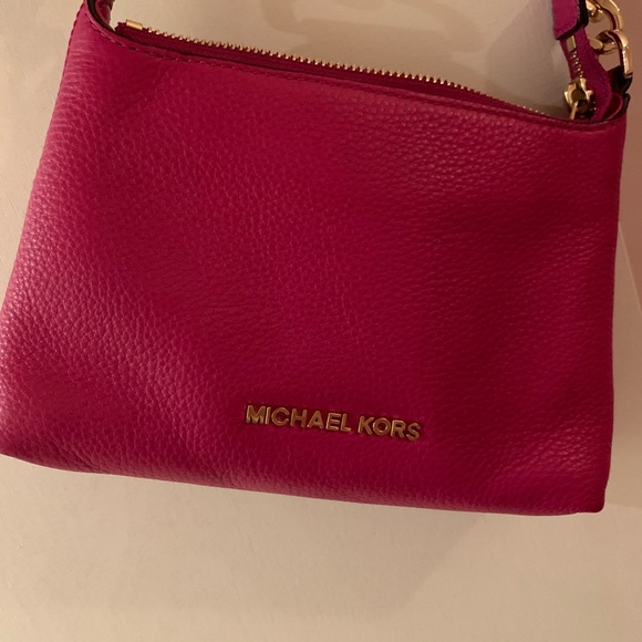 Michael Kors Handbags - A pink cross body bag. Only worn once